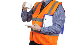 Building Surveyor in orange visibility vest having a tea break Royalty Free Stock Photos