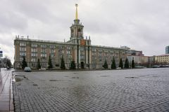 The building of the Sverdlovsk City Council with paved area on a cloudy day. Architectural monument. It is located In Ekaterinburg, on the `Square of 1905` Stock Photo