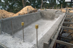 Building a swimming pool. Swimming pool being built; the pool was excavated and sprayed with concrete, now in the curing process Stock Photography