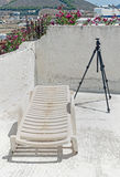 The building terrace with tripod and a lounge chair on Paros, Greece Stock Image