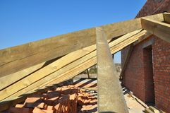 Building timber roof trusses for new attic house construction. Timber roof truss. Roofing construction. Stock Photography