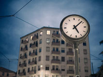 Building and the time. Building and the clock in the evening Stock Image