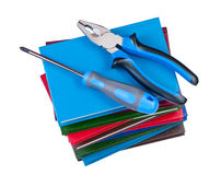 Building tool on a stack of books. Stock Image