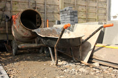 Building tools. Wheel barrow, cement mixer Stock Images
