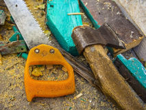 Building tools: Ax and saw Stock Photo