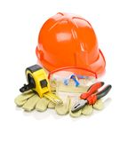 Building tools on gloves Stock Images