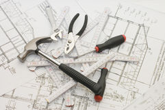 Building tools on the house plan Royalty Free Stock Photos