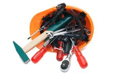 Building tools in an orange helmet Royalty Free Stock Image