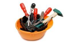Building tools in an orange helmet stock image