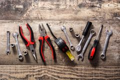 Building tools repair set on wooden background. Top view royalty free stock photos
