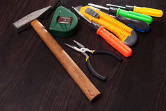 Building tools on wooden background, repair kit, bright screwdrivers, hammer, utility knife, Stock Photo