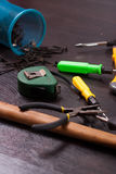Building tools on wooden background, repair kit, bright screwdrivers, hammer, utility knife, Stock Image