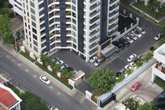 Building  Tower and cars from Bird eye view. Royalty Free Stock Images