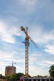 Building tower crane with sunset sky at the background Royalty Free Stock Photography