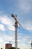 Building tower crane with sunset sky at the background Royalty Free Stock Images