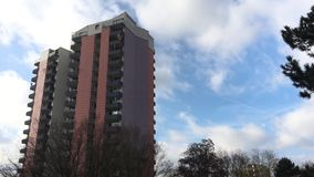 Building Tower, Tree and Clouds Time Lapse stock footage