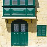 Balcony and door in Valletta. Building with traditional colorful maltese balcony and door in historical part of Valletta Stock Photos