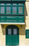 Balcony and door in Valletta. Building with traditional colorful maltese balcony and door in historical part of Valletta Stock Photo