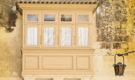 Traditional maltese balcony in Mdina. Building with traditional colorful maltese balcony in historical part of Mdina. The city was founded as Maleth in around Stock Photography