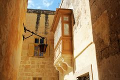 Building with traditional maltese balcony in historical part of Mdina.  Royalty Free Stock Photos