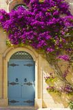 Maltese door decorated with flowers. Building with traditional maltese door decorated with fresh flowers in Mdina Stock Photography
