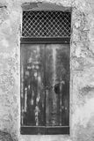 Maltese door in Valletta. Building with traditional maltese door in historical part of Valletta. Entrance to an abandoned house on the island of Malta. Black and Royalty Free Stock Image