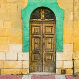 Traditional maltese door. Building with traditional maltese door in historical part of Valletta. Entrance to an old house on the island of Malta Stock Photos