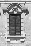 Maltese window in Valletta. Building with traditional maltese window in historical part of Valletta. Black and white picture Stock Photo