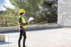 Building training, site visit, apprentice engineer on a construction site of house under construction stock photography