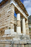 Building of Treasury of Athens in Ancient Greek archaeological site of Delphi, Greece Royalty Free Stock Images