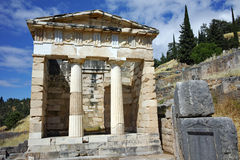 Building of Treasury of Athens in Ancient Greek archaeological site of Delphi, Greece Royalty Free Stock Image