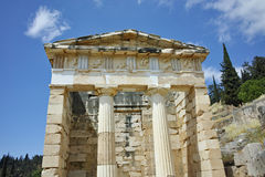 Building of Treasury of Athens in Ancient Greek archaeological site of Delphi, Greece Royalty Free Stock Photos