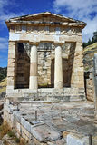 Building of Treasury of Athens in Ancient Greek archaeological site of Delphi, Greece Stock Images