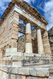 Building of Treasury of Athens in Ancient Greek archaeological site of Delphi, Greece Stock Photo