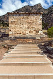 Building of Treasury of Athens in Ancient Greek archaeological site of Delphi, Greece Royalty Free Stock Photography