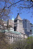 Building and trees. Financial district building in new york city surrounded by trees from battery park Stock Images