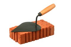 Building trowel and red brick Royalty Free Stock Photo