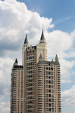 Building with turrets. Massive concrete construction with decorative turrets Royalty Free Stock Photography