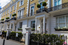 Building with the typical English architecture with columns Stock Photo