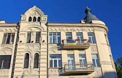 Building with Ukrainian flag in Kyiv, Ukraine. Building with Ukrainian flag on famous Andriyivskyy Descent in Kyiv, Ukraine Stock Image