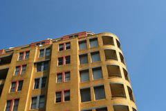 Building Under a Blue Sky. A partial shot of a building Stock Photography