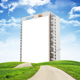 Building under blue sky with road Stock Image