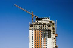 Building is under constraction. High contrast of blue sly and orange-white building Stock Photography