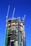 Building under construction. With big cranes over a clean blue sky background in London downtown, UK - Great Britan Stock Photography