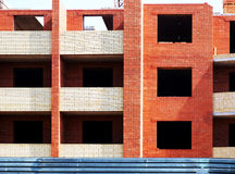 Building under construction. Multistory building from brick under construction closeup stock photos