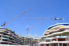 Building under construction. With cranes in the city Royalty Free Stock Photos
