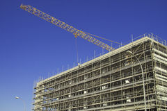 Building under construction. A building under construction with a crane working Stock Images