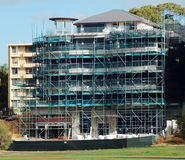 Building under construction. A building under construction with scaffolding stock images