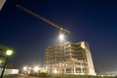 Building under construction. In nightly city Royalty Free Stock Photos