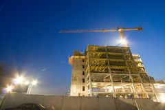Building under construction. In city at dawn Royalty Free Stock Image